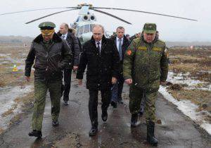 Russia's President Vladimir Putin (front C) and Defence Minister Sergei Shoigu (front L)  walk to watch military exercises upon his arrival at the Kirillovsky firing ground in the Leningrad region, on March 3, 2014. Crimea, the strategic host to tsarist and Kremlin navies since the 18th century, has been under de facto occupation by Moscow-backed forces since Putin won recently parliament's authorisation to send troops into Ukraine. AFP PHOTO/ RIA-NOVOSTI/ POOL/ MIKHAIL KLIMENTYEV        (Photo credit should read MIKHAIL KLIMENTYEV/AFP/Getty Images)