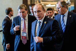 Russian President Vladimir Putin (C) arrives on day two of the G20 Turkey Leaders Summit on November 16, 2015 in Antalya. Putin said on November 16 that the attacks in Paris showed the need for his proposal for an international anti-terror coalition to be realised. AFP PHOTO / OZAN KOSE (Photo credit should read OZAN KOSE/AFP/Getty Images)