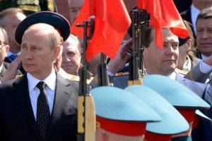 Russia's President Vladimir Putin (L) and Prime Minister Dmitry Medvedev (R) watch honour guard parading during a wreath laying ceremony at the Tomb of the Unknown Soldier outside the Kremlin in Moscow, on May 8, 2014, with Defence Minister Sergei Shoigu (2nd R) attending the ceremony. Russia is gearing up for hugely patriotic celebrations of its victory over Nazi Germany in World War II tomorrow, but festivities in neighbouring Ukraine will be muted amid fears of provocations.  AFP PHOTO / KIRILL KUDRYAVTSEV        (Photo credit should read KIRILL KUDRYAVTSEV/AFP/Getty Images)