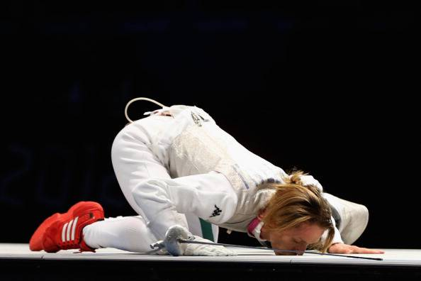 LONDON, ENGLAND - AUGUST 02:  Valentina Vezzali of Italy kisses the mat as she celebrates winning gold during her contest with Larisa Korobeynikova of Russia in the Women's Foil Team Fencing gold medal match against Russia on Day 6 of the London 2012 Olympic Games at ExCeL on August 2, 2012 in London, England.  (Photo by Hannah Peters/Getty Images)