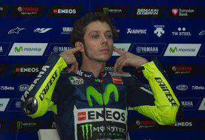 Movistar Yamaha rider Valentino Rossi of Italy adjusts his ear plugs before the third and final day of MotoGP test races at the Sepang circuit outside Kuala Lumpur on February 25, 2015. AFP PHOTO / MOHD RASFAN        (Photo credit should read MOHD RASFAN/AFP/Getty Images)
