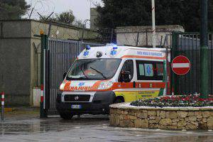 """An ambulance carrying several injured passengers evacuated by helicopter from the burning ferry """"Norman Atlantic"""" adrift off Albania, leaves the Fortunato Cesari military airport in Galatina, southern Italy, on December 28, 2014. Desperate passengers pleaded by mobile phone live on TV to be saved from a burning ferry adrift off Albania on Sunday as rescuers battled gale-force winds and billowing smoke to get to them. AFP PHOTO / NUNZIO GIOVE        (Photo credit should read NUNZIO GIOVE/AFP/Getty Images)"""