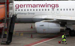 BERLIN, GERMANY - SEPTEMBER 09: An airplane belonging to the airline Germanwings, Lufthansa's low-cost carrier, is seen on the tarmac during a strike by Lufthansa pilots at Tegel airport on September 9, 2015 in Berlin, Germany. Pilots from German airline Lufthansa are striking for a second day, their thirteenth strike in 18 months, despite the carrier's efforts to stop it. A resulting 1,000 flights have been cancelled, affecting approximately 140,000 passengers. The pilots' union, Vereinigung Cockpit, said additional strikes would occur if the airline's management did not favorably resolve a cost-cutting dispute concerning salaries, retirement benefits, and the airline's plans to expand its low-cost operations. (Photo by Adam Berry/Getty Images)
