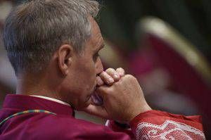 The prefect of the papal household Georg Gaenswein is pictured during a papal mass for the 14th Ordinary General Assembly of the Synod of Bishops at St Peter's basilica on October 25, 2015 at the Vatican.  AFP PHOTO / ANDREAS SOLARO        (Photo credit should read ANDREAS SOLARO/AFP/Getty Images)