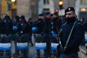 Policemen stand in front of La Scala opera house before the Premiere of Giovanna d'Arco (Joan of Arc) of Giuseppe Verdi for the season opener 2015/2016, on December 7, 2015 in Milan. The season opener is one of the most glittering events on Europe's culture calendar, attended by leading figures of Italian industry, fashion and politics. AFP PHOTO / GIUSEPPE CACACE / AFP / GIUSEPPE CACACE (Photo credit should read GIUSEPPE CACACE/AFP/Getty Images)