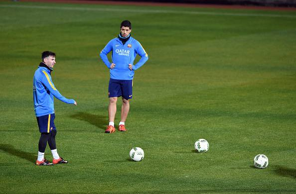 Messi e Suarez in allenamento (Photo credit should read TORU YAMANAKA/AFP/Getty Images)