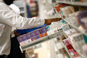 A pharmacist looks for medication on a pharmacy's shelves in London, U.K., on Monday, Dec. 14, 2015. European pharmaceuticals stocks in 2015 have outperformed the Stoxx 600 Index by 1.2 percentage points in U.S. dollar terms. Photographer: Simon Dawson/Bloomberg via Getty Images