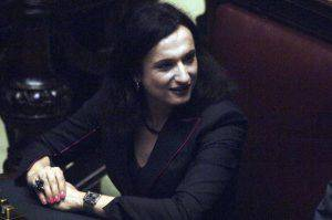 ROME - APRIL 28:  Newly elected center-left coalition deputy Wladimiro Guadagno, also known as Vladimir Luxuria, 40, attends the opening session of the Italian parliament at the lower house Chamber of Deputies on April 28, 2006 in Rome, Italy. Luxuria is the first transgendered person elected to Italy's national parliament. This is the first parliamentary session since Romano Prodi's centre-left coalition won in the April 9-10 election. (Photo by Franco Origlia/Getty Images)