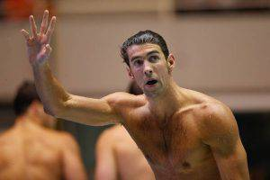FEDERAL WAY, WA - DECEMBER 04: Michael Phelps waves to the crowd after winning the 100 Meter Butterfly during the finals of the AT&T Winter National Championships at the Weyerhaeuser King County Aquatic Center on December 4, 2015 in Federal Way, Washington. (Photo by Otto Greule Jr/Getty Images)