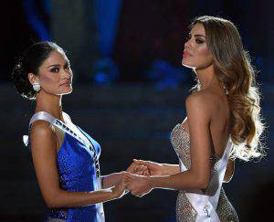 LAS VEGAS, NV - DECEMBER 20: Miss Philippines 2015, Pia Alonzo Wurtzbach (L), and Miss Colombia 2015, Ariadna Gutierrez (R), wait for the judges' final decision in the 2015 Miss Universe Pageant at The Axis at Planet Hollywood Resort & Casino on December 20, 2015 in Las Vegas, Nevada. Wurtzbach was named the new Miss Universe after host Steve Harvey accidentally named Gutierrez the winner. (Photo by Ethan Miller/Getty Images)