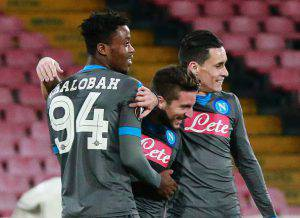 Napoli's Belgian forward Dries Mertens (C) celebrates with teammates French midfielder Nathaniel Chalobah (L) and Napoli's Spanish forward Jose Maria Callejon after scoring during the UEFA Europa League football match Napoli vs Legia Warsaw at the San Paolo stadium on December 10, 2015 in Naples. AFP PHOTO / CARLO HERMANN / AFP / CARLO HERMANN (Photo credit should read CARLO HERMANN/AFP/Getty Images)