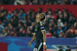 Juventus' French midfielder Paul Pogba reacts after missing a goal opportunity during the UEFA Champions League Group D football match Sevilla FC vs Juventus at the Ramon Sanchez Pizjuan stadium in Sevilla on December 8, 2015. AFP PHOTO/ CRISTINA QUICLER / AFP / CRISTINA QUICLER (Photo credit should read CRISTINA QUICLER/AFP/Getty Images)