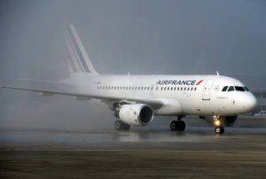 An Air France medium haul Airbus A319 with a new cabin version is greeted by water jets on the tarmac at Roissy Charles de Gaulle airport after its landing  on March 18, 2015.  AFP PHOTO ERIC PIERMONT        (Photo credit should read ERIC PIERMONT/AFP/Getty Images)