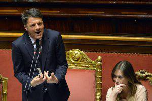 Italian Prime Minister Matteo Renzi (L) gives a speech, next to Maria Elena Boschi, Minister of Constitutional Reforms, at the Upper House of Parliament in Rome on April 22, 2015, after observing a minute of silence in memory of the 800 migrants feared to have died when a boat packed with migrants capsized near Libya. European governments were under mounting pressure to act decisively on the Mediterranean migrant crisis as harrowing details emerged of the fate of those who died in the worst tragedy to date. AFP PHOTO / ANDREAS SOLARO (Photo credit should read ANDREAS SOLARO/AFP/Getty Images)