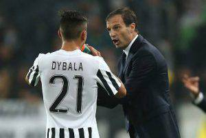 "Juventus' Argentinian forward Paulo Dybala talks with Juventus' coach Massimiliano Allegri (R ) during the Italian Serie A  football match Juventus Vs Torino on October 31, 2015 at the ""Juventus Stadium"" in Turin.  AFP PHOTO / MARCO BERTORELLO        (Photo credit should read MARCO BERTORELLO/AFP/Getty Images)"