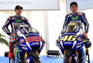 Rossi-Lorenzo (Photo credit should read LLUIS GENE/AFP/Getty Images)