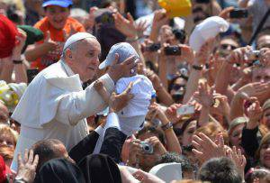 Pope Francis caresses a baby  on May 12, 2013, in St.Peter's Square at Vatican at the end of a service, canonising some 800 Italian martyrs who refused to convert to Islam in the 15th century, as well as a Colombian and a Mexican who founded congregations  AFP PHOTO/ VINCENZO PINTO        (Photo credit should read VINCENZO PINTO/AFP/Getty Images)