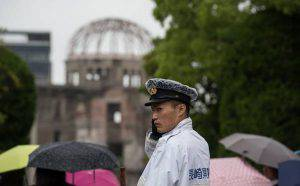 A policeman stands in front of the Peace Memorial Genbaku Dome in the Hiroshima Peace Memorial park in Naka Ward, Hiroshima Prefecture on May 25, 2016.  Barack Obama is set to become the first sitting US president to visit Hiroshima when he journeys on May 27 with Japanese Prime Minister Shinzo Abe, hallowed ground to Japanese but, for more than 70 years, a no-go zone for 11 of his Oval Office predecessors. / AFP / JOHANNES EISELE        (Photo credit should read JOHANNES EISELE/AFP/Getty Images)