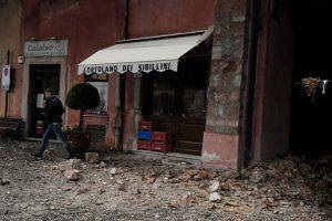 CORRECTION - A man walks past rubbles in the village of Visso, central Italy, after earthquakes on October 26, 2016. Twin earthquakes rocked central Italy on October 26, 2016 -- the second registering at a magnitude of 6.0 -- in the same region struck in August by a devastating tremor that killed nearly 300 people. The quakes were felt in the capital Rome, sending residents running out of their houses and into the streets. The second was felt as far away as Venice in the far north, and Naples, south of the capital. / AFP / TIZIANA FABI / The erroneous mention[s] appearing in the metadata of this photo by TIZIANA FABI has been modified in AFP systems in the following manner: [Visso] instead of [Borgo Sant'Antonio]. Please immediately remove the erroneous mention[s] from all your online services and delete it (them) from your servers. If you have been authorized by AFP to distribute it (them) to third parties, please ensure that the same actions are carried out by them. Failure to promptly comply with these instructions will entail liability on your part for any continued or post notification usage. Therefore we thank you very much for all your attention and prompt action. We are sorry for the inconvenience this notification may cause and remain at your disposal for any further information you may require.        (Photo credit should read TIZIANA FABI/AFP/Getty Images)