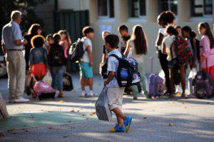A pupil arrives in the courtyard of the Abbe de l'Epee elementary school on September 3, 2013 in Marseille, southern France, prior to enter her classroom on the first day of school. More than 12 million pupils went back to school today in France.AFP PHOTO / ANNE-CHRISTINE POUJOULAT        (Photo credit should read ANNE-CHRISTINE POUJOULAT/AFP/Getty Images)