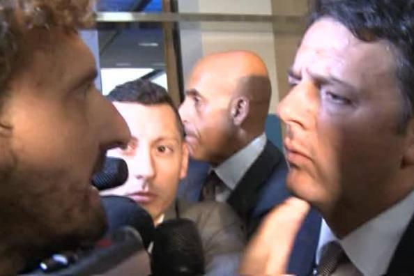 Filippo Roma e Matteo Renzi (ritaglio video)