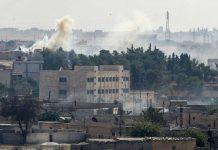 Siria bombe civili giornalista