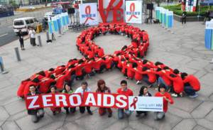 Slogan contro l'Aids (PATRICK LIN/AFP/Getty Images)