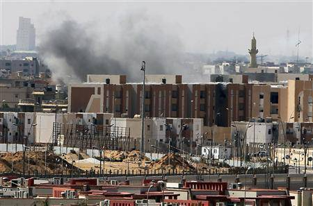 Smoke is seen rising over the city of Sirte
