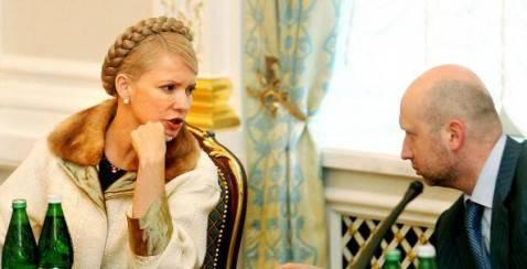 Yulia Tymoshenko e Aleksander Turchinov (SERGEI SUPINSKY/AFP/Getty Images)
